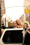 Blonde bride and groom at door of their limo on Park Avenue, NYC