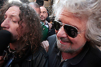 Beppe Grillo .Roma 04/03/2013 Hotel Universo. Beppe Grillo esce dall'hotel dopo il vertice del Movimento 5 Stelle e viene presso d'assalto dai media..Beppe Grillo gets out the Universo Hotel after the summit with the new elected fo 'Movimento 5 Stelle' at the last Elections 2013 and he is assaulted by the media..Photo Samantha Zucchi Insidefoto