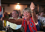 09 June 2006: A lone Costa Rica fan in a Munich bar packed with German fans celebrates after a second half goal by Costa Rica. Germany played Costa Rica at the Allianz Arena in Munich, Germany in the opening match, a Group A first round game, of the 2006 FIFA World Cup.