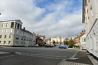 BNPS.co.uk (01202 558833)<br /> Pic: ZacharyCulpin/BNPS<br /> <br /> The roads around Poundbury in Dorset pictured without road markings or road signage. <br /> <br /> Prince Charles' Duchy of Cornwall has been accused of defying a coroner after he raised concerns about the safety of the roads in Prince Charles' designer village following the death of a motorcyclist.Dorset Assistant Coroner Brendan Allen wrote to the Duchy of Cornwall calling on them to take 'urgent action' after Richard Hallett, 25, was killed after colliding with a van in Poundbury, Dorset.The inquest heard both parties were travelling at low speed and there was 'a lack of road markings and sightlines' at the fatal junction. Charles' utopian idyll has been specifically designed with winding streets and blind bends to calm traffic, instead of conventional stop signs.Mr Allen, in his report, said the evidence he heard 'gave rise to concern' and that the Duchy of Cornwall must act 'to prevent future deaths'. But he has since received a response from them claiming there is no evidence of a 'clustering of accidents' or 'black spots' in Poundbury.Mr Hallett's mother, Tina Cooper, claimed the Duchy of Cornwall's aversion to road signs demonstrated they put 'the prettiness of the town' above saving lives.