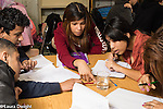 Education High School group of students working on science experiment