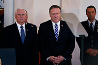 United States Vice President Mike Pence and United States Secretary of State Mike Pompeo wait for United States President Donald J. Trump to deliver remarks regarding the Iranian attack on two U.S. military bases in Iraq in the Grand Foyer of the White House on Wednesday, January 8, 2019.  The attack is said to be in retaliation for the U.S. drone strike that killed Iranian Military Leader Qasem Soleimani in Baghdad, Iraq on Friday, January 3, 2020. <br /> <br /> Credit: Stefani Reynolds / CNP/AdMedia