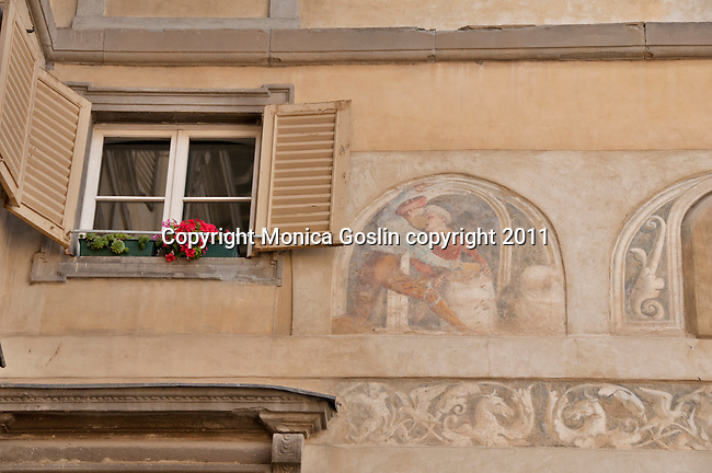 Architectural detail of frescos on a building in Bergamo, Italy