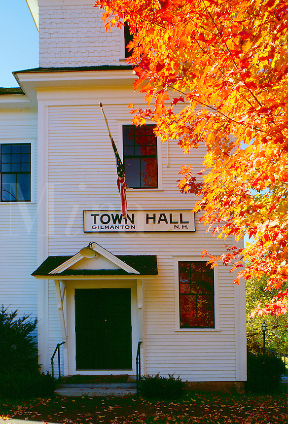 Small town America - the Gilmantown Town Hall with fall foliage. New Hampshire.