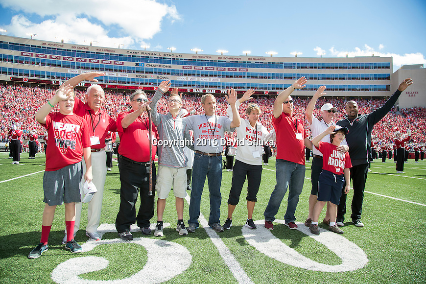 Wisconsin Badgers 2016 Hall of Fame Inductees sing Varstiy during an NCAA college football game against the Georgia State Panthers Saturday, September 17, 2016, in Madison, Wis. The Badgers won 23-17. (Photo by David Stluka)