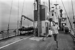 Pirate radio station Radio Laser off the coast of Felixstowe Suffolk 1980s UK.  DJ Ric Harris keeping fit on deck. 1984