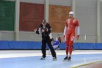 SCHAATSEN: SALT LAKE CITY: Utah Olympic Oval, 12-11-2013, Essent ISU World Cup, training, Wim den Elsen (trainer KIA Speed Skating Academy), Artur Was (POL), ©foto Martin de Jong