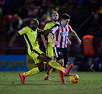 Lincoln City's Tom Pett vies for possession with Cheltenham Town's Nigel Atangana<br /> <br /> Photographer Chris Vaughan/CameraSport<br /> <br /> The EFL Sky Bet League Two - Lincoln City v Cheltenham Town - Tuesday 13th February 2018 - Sincil Bank - Lincoln<br /> <br /> World Copyright &copy; 2018 CameraSport. All rights reserved. 43 Linden Ave. Countesthorpe. Leicester. England. LE8 5PG - Tel: +44 (0) 116 277 4147 - admin@camerasport.com - www.camerasport.com