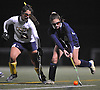 Baldwin No. 14 Daniella Specht, right, gets pressured by Massapequa No. 13 Alexandra Kanapes during the Nassau County varsity field hockey Class A final at Adelphi University on Saturday, October 31, 2015. Massapequa won by a score of 2-1.<br /> <br /> James Escher<br /> <br /> James Escher