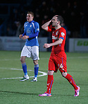 Agony for Nicky Clark at the final whistle as the Rangers players walk off dejected