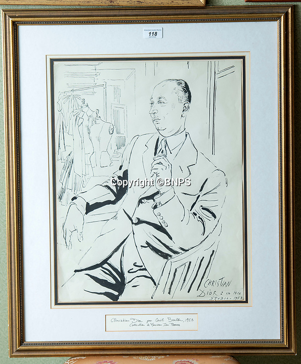 BNPS.co.uk (01202 558833)<br /> Pic: PhilYeomans/BNPS<br /> <br /> Cecil Beaton sketch of Christian Dior, in his studio 1953<br /> <br /> A remarkable 'time warp' Royal archive amassed by the Queen's dressmaker has been found inside his old country home.<br /> <br /> The late Ian Thomas was a dress designer for members of the Royal Family, including Her Majesty, for over 30 years.<br /> <br /> As an apprentice he worked alongside the renowned fashion designer Norman Hartnell on creating the Queen's coronation dress in 1953.<br /> <br /> His archive includes embroidered samples of the gown worn by Elizabeth II for the historic ceremony in Westminster Abbey that was broadcast to millions.<br /> <br /> Mr Thomas also designed outfits for the Queen Mother and Princess Margaret.