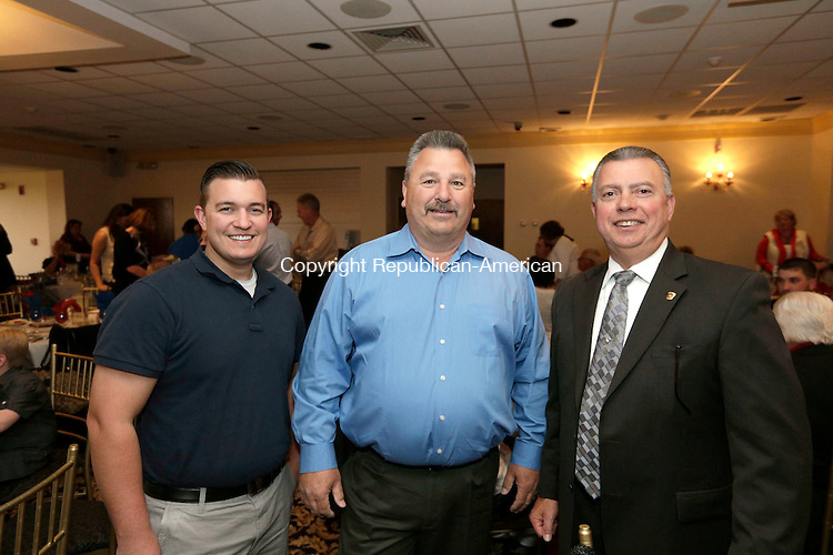 Wolcott, CT- 25 April 2015-042516CM09- SOCIAL MOMENTS--- From left to right, Justin Stephens of Waterbury, David Bromley of Watetown and Wolcott Police Chief, Edward Stephens  are photographed during The Exchange Club of Wolcott's annual Public Service Awards Banquet at Mahan's Lakeview Fine Catering on in Wolcott on Monday, April 25.  Christopher Massa Republican-American