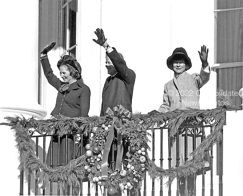 """Prime Minister Margaret Thatcher of the United Kingdom, left, United States President Jimmy Carter, center, and first lady Roslyn Carter, right, wave from the Truman Balcony at the White House in Washington, D.C. on Monday, December 17, 1979. Mrs. Thatcher arrived in Washington for her first visit to the United States as Prime Minister.  Thatcher died from a stroke at 87 on Monday, April 8, 2013..Credit: Benjamin E. """"Gene"""" Forte - CNP"""