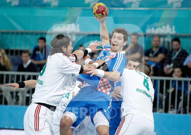 Croatia's Damir Bicanic (c) and Hungary's Laszlo Nagy (l) and Szabolcs Szollosi during 23rd Men's Handball World Championship preliminary round match.January 15,2013. (ALTERPHOTOS/Acero)