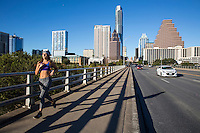 The Congress Avenue Bridge is a popular running and jogging fitness training route know for it's scenic view of Lady Bird Lake in downtown Austin, Texas - Stock Image.