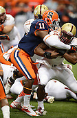 Syracuse Orange linebacker Marquis Spruill (11) tackles Boston College Eagles running back Andre Williams (44) during a game at the Carrier Dome on November 30, 2013 in Syracuse, New York.  Syracuse defeated Boston College 34-31.  (Copyright Mike Janes Photography)