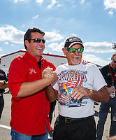 Sep 3, 2016; Clermont, IN, USA; NHRA former top fuel driver Don Garlits (right) with Papa Johns pizza founder John Schnatter during qualifying for the US Nationals at Lucas Oil Raceway. Mandatory Credit: Mark J. Rebilas-USA TODAY Sports