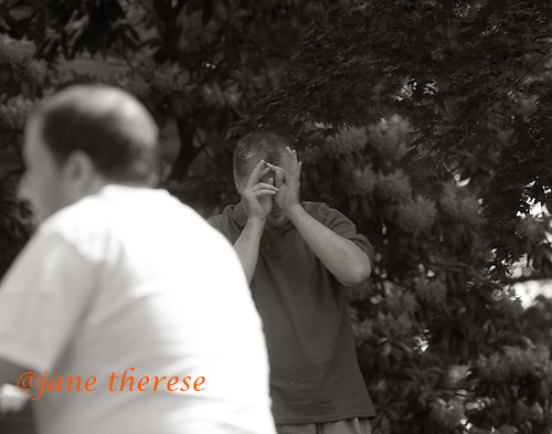 Larry who is autistic, has a moment during a Memorial Day Picnic with other residents at The Sobolevitch House in Robbinsville, NJ. on Monday May 29, 2006. photo by jane therese