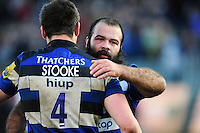 Kane Palma-Newport of Bath Rugby embraces team-mate Elliott Stooke after the match. Aviva Premiership match, between Bath Rugby and Harlequins on February 18, 2017 at the Recreation Ground in Bath, England. Photo by: Patrick Khachfe / Onside Images