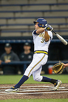 Michigan Wolverines outfielder Cody Bruder (3) follows through on his swing against the Oakland Golden Grizzlies on May 17, 2016 at Ray Fisher Stadium in Ann Arbor, Michigan. Oakland defeated Michigan 6-5 in 10 innings. (Andrew Woolley/Four Seam Images)