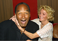 OJ Simpson and friend Tammy Wu 2002<br /> Photo By Adam Scull/CelebrityArchaeology.com