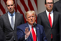 United States President Donald J. Trump delivers remarks before signing H.R. 7010 - PPP Flexibility Act of 2020 in the Rose Garden of the White House in Washington, DC on June 5, 2020.  Looking on from left is US Secretary of Labor Eugene Scalia and from right is US Secretary of the Treasury Steven T. Mnuchin.<br /> Credit: Yuri Gripas / Pool via CNP/AdMedia