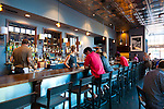 Artisan Restaurant in Paso Robles, CA. Patrons dine at the bar