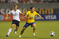 Therese Sjogran (yellow), Kate  Markgraf...USWNT tied Sweden 1-1 at Morison Stadium, Nebraska.