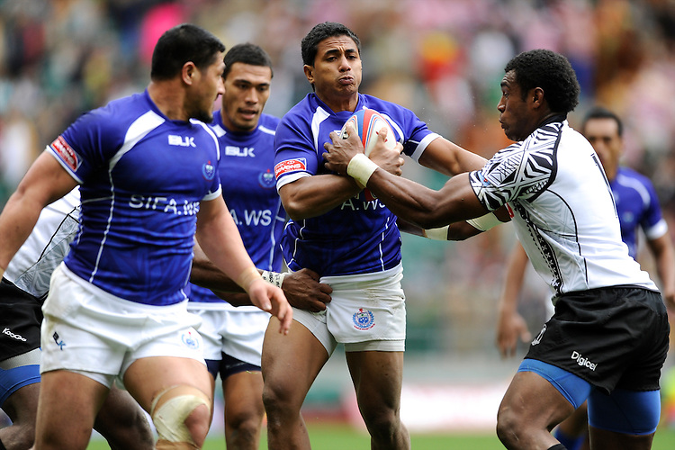 Sani Niue of Samoa is tackled by Nemani Nagusa of Fiji   during the iRB Marriott London Sevens at Twickenham on Saturday 11th May 2013 (Photo by Rob Munro)