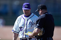 High Point Panthers head coach Craig Cozart (38) looks on as home plate umpire David Pritchett reviews the lineup card prior to the game against the NJIT Highlanders at Williard Stadium on February 19, 2017 in High Point, North Carolina. The Panthers defeated the Highlanders 6-5. (Brian Westerholt/Four Seam Images)