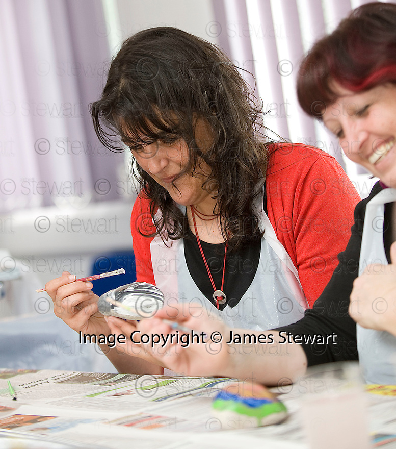 :: INTERCULTURAL PATCHWORK ::<br /> PARTICIPANTS FROM SEVERAL COUNTRIES PAINT ROCKS WITH THEIR OWN PERSONAL DESIGN AT THE DAWSON CENTRE. THE ROCKS WILL BE USED TO FORM A CAIRN AS PART OF THE HELIX PROJECT IN ABBOTSHAUGH WOODLAND.