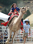 Teri Vance competes in a media exhibition race at the 56th annual International Camel &amp; Ostrich Races in Virginia City, Nev. on Friday, Sept. 11, 2015. <br /> Photo by Cathleen Allison