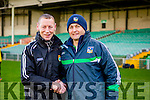 new Kerry manager Ciaran Carey with his old teammate Limerick manager TJ Ryan greet each other before the Munster cup clash in the Gaelic Grounds on Sunday