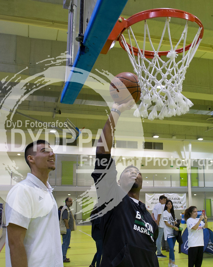 Guillermo Hernangomez Geuer and Marcus Smart during clinic with kids
