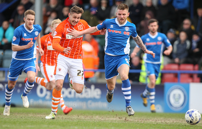 Blackpool's Jacob Blyth is held back by Rochdale's Ashley Eastham<br /> <br /> Photographer Alex Dodd/CameraSport<br /> <br /> Football - The Football League Sky Bet League One - Rochdale v Blackpool - Saturday 16th April 2016 - Spotland - Rochdale   <br /> <br /> &copy; CameraSport - 43 Linden Ave. Countesthorpe. Leicester. England. LE8 5PG - Tel: +44 (0) 116 277 4147 - admin@camerasport.com - www.camerasport.com