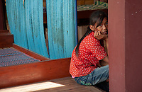 A girl is waiting at a local clinic. Activities and way of life, around and on the Tonle Sap Lake, Siem Reap area, Cambodia