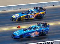 Jul 30, 2017; Sonoma, CA, USA; NHRA funny car driver Tommy Johnson Jr (near) races alongside Ron Capps during the Sonoma Nationals at Sonoma Raceway. Mandatory Credit: Mark J. Rebilas-USA TODAY Sports