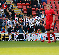 Grimsby Town's Sam Jones is mobbed after he scores during the Sky Bet League 2 match between Leyton Orient and Grimsby Town at the Matchroom Stadium, London, England on 11 March 2017. Photo by Carlton Myrie / PRiME Media Images.