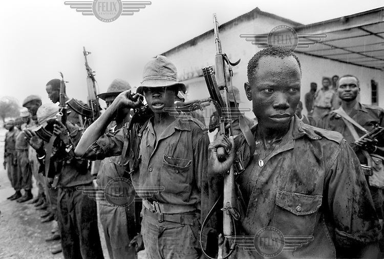 Fighters of the Sudanese People's Liberation Army (SPLA) prepare for a patrol in Kapoeta, southern Sudan, September 22, 1987. More than a million people have died since 1983 as a result of the civil war between the Islamic government forces and mainly Christian and animist southerners.