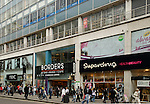 View of eastern section of Oxford Street shops and passing shoppers, London