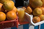 Oranges and glass of freshly squeezed orange juice, Essaouira, Morocco