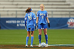 08 December 2013: UCLA's Samantha Mewis (22) and Sarah Killion (16). The Florida State University Seminoles played the University of California Los Angeles Bruins at WakeMed Stadium in Cary, North Carolina in a 2013 NCAA Division I Women's College Cup championship game. UCLA won the game 1-0 in overtime.