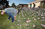 U.S. Marines veteran John Warden and other Western Nevada College Veterans Resource Center volunteers plant nearly 8,000 American flags at the campus, in Carson City, Nev., on Friday, May 1, 2015. The group will hold a Veterans Suicide Walk Saturday, May 2 at starting 10 a.m. at Bully's Sports Bar and Grill to help raise awareness of the 8,030 veteran suicides each year. <br /> Photo by Cathleen Allison/Nevada Photo Source