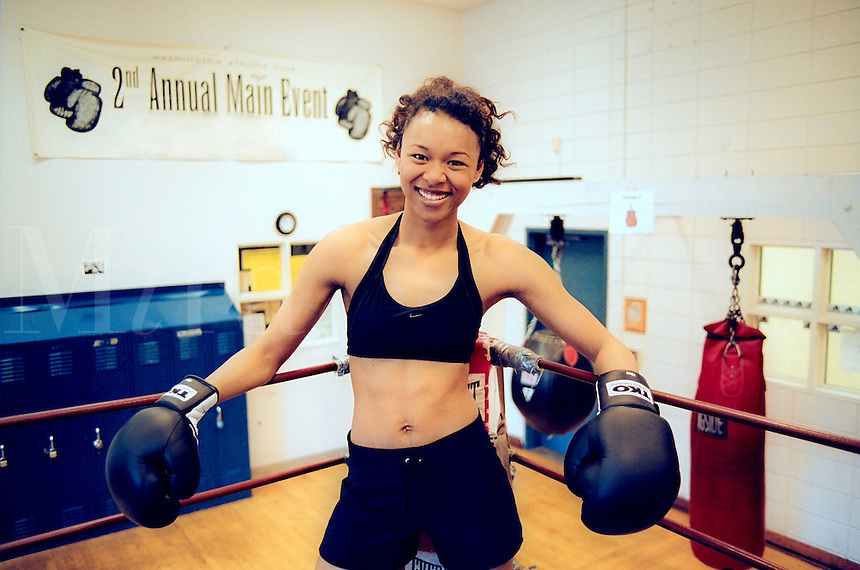 smiling woman in boxing ring..MR