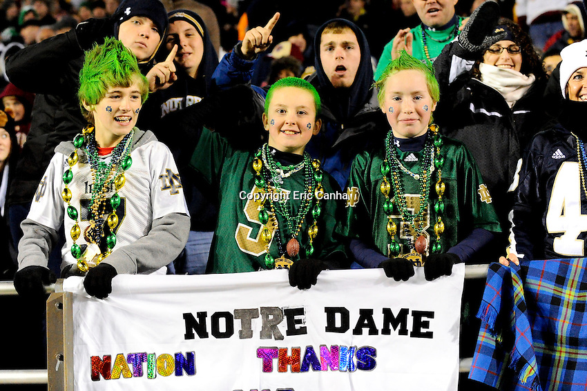 Young fans cheer on the team during the Boston College Eagles vs Notre Dame Fighting Irish NCAA football game held at Alumni Stadium, in Chestnut Hill, Massachusetts.   Eric Canha/CSM