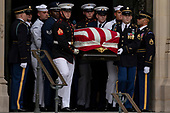 A Military Honor Guard carries the casket of late Senator John McCain, Republican of Arizona, followed by his family after a funeral service at the Washington National Cathedral in Washington, DC on September 1, 2018. <br /> Credit: Alex Edelman / CNP