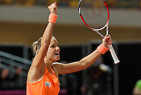 Februari 08, 2015, Apeldoorn, Omnisport, Fed Cup, Netherlands-Slovakia, Arantxa Rus (NED)  jubilates her victory Holland wins 3-1 <br /> Photo: Tennisimages/Henk Koster