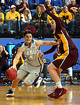BROOKINGS, SD - MARCH 27:  Steph Paluch #15 from South Dakota State University drives against Kayla Hirt #20 from the University of Minnesota in the first half of their sweet sixteen gameThursday night at Frost Arena in Brookings. (Photo by Dave Eggen/Inertia)
