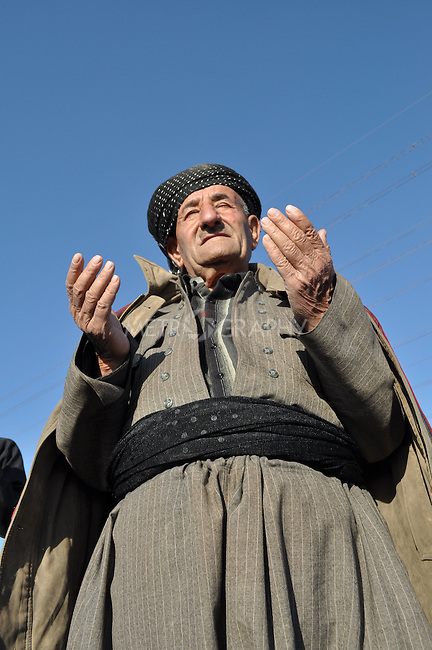 GOIZHA, IRAQ: An Iraqi Kurdish man prays for rain...The current fall and winter have been extremely dry in northern Iraq.  A number of Islamic parties in the north of the country organized mass prayer gatherings to combat the coming drought...Photo by Sartep Osman/Metrography