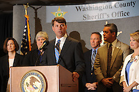 NWA Democrat-Gazette/ANDY SHUPE<br /> Conner Eldridge, U.S. Attorney for the Western District of Arkansas, speaks Wednesday, Aug. 5, 2015, alongside law enforcement and area school representatives to announce the implementation of the Arkansas Defending Childhood Initiative at the Washington County Sheriff's Office in Fayetteville. The program would inform school districts after one of their students experiences a violent, criminal or traumatic event involving law enforcement.
